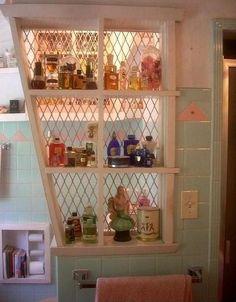 1950s Bathroom. Notice the little bookshelf built into the tp holder!