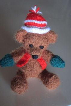 Knitted Christmas Teddy Ornament - Pattern made up of  http://www.ravelry.com/patterns/library/christmas-tree-keepsakes - for the head but my own pattern for the rest of him.