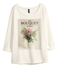 This sweet white sweatshirt top with printed bouquet graphic is for the true romantic. | H&M Divided