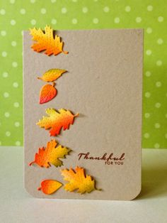 hand made Thanksgiving card from three umbrellas .. kraft ... die cut leaves colored in bright yellows and orange tumble down the page ...