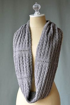 Ellery Cowl Free Knitting Pattern (downloadable pdf). I like the combination of stitches here, faux cables (which are reversible) and eyelet row. I'd like these stitches on a baby project (baby shawl? sweater?)
