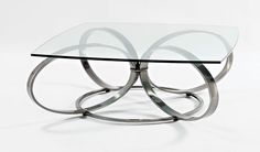 JOHNSTON CASUALS. The Fiore cocktail table has chrome finish and flowing design. Featured in the May 6, 2013, Issue of Furniture Today. http://johnston.nextmp.net/index.php/fiore-cocktail-table.html