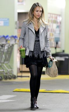 Whole Foods Run from Jessica Alba's Street Style  Green juice in hand, she heads out of Whole Foods in a statement gray bomber jacket with a boho LBD and black tights.