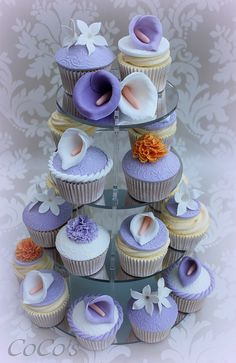 purple and peach cupcake tower by Coco's #Cupcakes Camberley www.findiforweddings.com