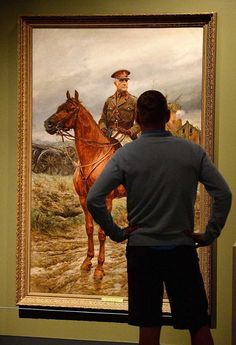 """10-5-14 - Canada - Museums at home and abroad keep memories of the First World War alive. Shown, A man views a portrait of Sir Sam Hughes painted by R. Caton Woodville around 1915 while visiting an exhibit titled """"Witness-Canadian Art Fom The First World War"""" that was on display at the National War Museum in Ottawa this summer."""