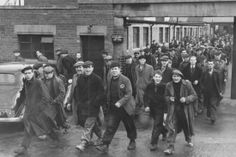 The hungry workers pouring out of the main gates for their lunch break at Smiths Dock Co Limited, North Shields, 14 December 1956