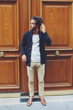 Consider wearing a navy shawl cardigan and beige chinos to look classy but not particularly formal. A pair of brown leather double monks will bring a strong and masculine feel to any ensemble.