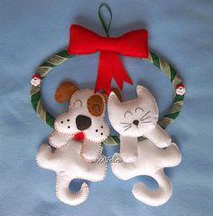 Essa guirlanda natalina com gatinho e cachorrinho foi adquirida em um dos bazares que participei e a moça iria presentear uma veterinária!...