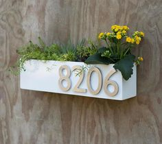 Welcome Home. This modern address plaque and trough wall planter adds flair and style to the facade of your home with aluminum address numbers. Door Number Sign, Door Numbers, Address Numbers, Address Plaque, House Numbers, Succulent Hanging Planter, Succulent Wall, Hanging Planters, Name Plate Design
