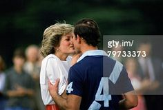 GREAT BRITAIN - JUNE 30: Prince Charles, Prince of Wales kisses Diana, Princess of Wales after she presents him with a prize at polo in Cirencester (Photo by Tim Graham/Getty Images)