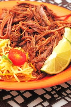 Copycat Slow Cooker Chipotle Barbacoa Beef Recipe with Chuck Roast, Apple Cider Vinegar, Lime Juice, Chipotle Pepper, Garlic, Oregano and Cloves - 15 Minute Prep Time - Gluten Free and Low Carb