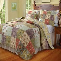 Country Cottage Patchwork 100 percent Cotton Floral Quilt and Shams Set.  Bedding set is made of 100% cotton cover and fill.  Reversible to a coordinating design.