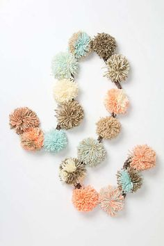 Anthropologie - Kamuro Pom Scarf. Can be DIY'd into a garland using any color yarn to match the occasion.