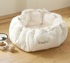 Diy? Round bed that you can cinch up. I know this is meant for cats but Lucky would love this.