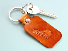 Know someone who really loves wolves? This handmade leather Wolf keyring would make an excellent lea Know someone who really loves wolves? This handmade leather Wolf keyring would make an excellent le Leather Bookmark, Leather Keyring, Leather Gifts, Handmade Leather, Birthday Gifts For Husband, 30th Birthday Gifts, Fathers Day Gifts, Gifts For Dad, Handmade Father's Day Gifts