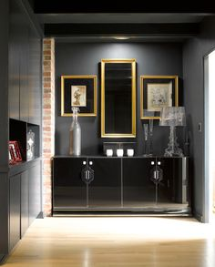 Chic black foyer with black walls framing gold frames, Kartell Bourgie Lamp and glossy black lacquer cabinet. Dark Grey Walls, Black Walls, Basement Inspiration, Black Cabinets, White Home Decor, White Houses, Dream Decor, Home Decor Furniture, Home Projects