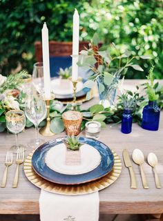 Love the blues, gold and greens in this place setting & table decor: http://www.stylemepretty.com/2014/10/28/romantic-navy-italian-inspired-wedding/ | Photography: Ashley Bosnick - http://ashleybosnick.com/