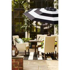 Allen Roth 9 Ft Octagon Black And White Stripe With Brown Steel Frame Auto Tilt Market Patio Umbrella Lowes Com Patio Umbrella Patio White Outdoor Table