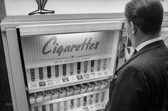 "April 20, 1965. ""Vending Machines, Cigarettes."" 35mm negative by Marion S. Trikosko for U.S. News & World Report."