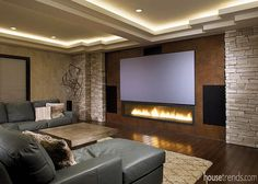 This home theater design includes rope lighting in the ceiling and a large contemporary fireplace placed under the television screen. Home theater design Basement remodel a social butterfly Home, Home Cinema Room, Basement Remodeling, Contemporary Fireplace, Home Entertainment, Basement Bar Designs, New Homes, Home Theater, Fireplace