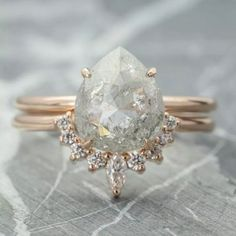 Check this pear shaped diamond engagement ring set. Hand-tailored to perfection, this halo engagement ring set features an intricately white gold ring with a substantial natural conflict free diamond focal that has been set in a custom-made decorative Pear Diamond Engagement Ring, Classic Engagement Rings, Morganite Engagement, Engagement Ring Settings, Diamond Wedding Rings, Bridal Rings, Diamond Rings, Solitaire Diamond, Halo Engagement