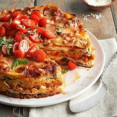 Meatless Lasagna - This vegetarian layered beauty is stacked with fresh vegetables, aromatic herbs, three kinds of Italian cheeses, and a rich, hearty tomato-basil sauce. Our Mile-High Meatless Lasagna Pie is ideal for a special-occasion dinner. Vegetarian Pasta Dishes, High Protein Vegetarian Recipes, Healthy Recipes, Vegetarian Pie, Healthy Lunches, Delicious Recipes, Healthy Foods, Baked Pasta Recipes, Cheesy Recipes