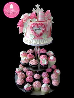 Pink First Communion cake and cupcakes