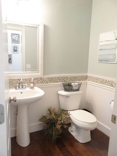 Add a strip of glass tiles in bathroom
