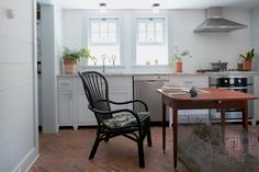 The black rattan Storsele chair in the kitchen is from Ikea ($119). Ms. Gray refinished the antique cherry table herself.