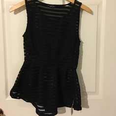 Black peplum top. Never worn. Fits like a small. Has a side zipper Tops Blouses