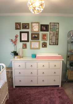 White dresser with changing pad...this is a basic idea of what I want to do. Not the wall decor, just the dresser with the changing pad.