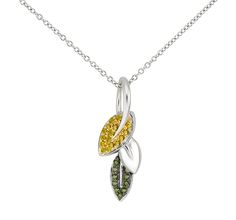 Stunning yellow and green highest quality cz's micro pave set in sterling silver leaf design.  Will quickly become your favorite fall necklace.    Chain included  This is from our custom designed collection.