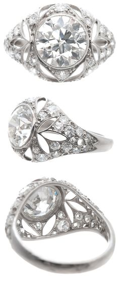 1920's Very Fine Old European Cut Diamond Platinum Ring. A fantastic one-of-a-kind and all-original Art Deco diamond ring. Handmade and hand pierced, this platinum setting is made with masterful craftsmanship and attention to detail! Equally as fine as the make of the ring is the center stone, a GIA certified 2.03 H-I color VVS2-VS1 clarity Old European Cut diamond (extremely white for Old European Cut diamonds). An additional 36 diamonds adorn the setting, weighing 0.92 carats. Via 1stdibs.