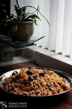 """Lamb Plov with Dried Apricots, a traditional recipe from Tajikistan made with rice, carrot, turnip, onion, cumin, and lamb. (Recipe includes """"Top 5 Tips for eating from a Communal Platter"""")"""