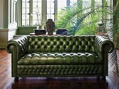 The Chesterfield sofa conjures images of formally attired gentlemen sequestered in a dark paneled study, sipping brandy and smoking cigars. Throughout history the Chesterfield sofa has come to repr… Sofa Green, Green Leather Sofa, Best Leather Sofa, Leather Loveseat, Leather Chairs, Sofa Design, Furniture Design, Interior Design, Furniture Ideas