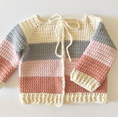 Crochet Four Color Baby Sweater I've made three versions of this sweater using the same pattern, but different yarn for each one. I really wanted… The post Crochet Four Color Baby Sweater appeared first on Daisy Farm Crafts. Crochet Baby Cardigan Free Pattern, Crochet Baby Sweaters, Baby Sweater Patterns, Baby Girl Crochet, Crochet Baby Clothes, Crochet Jacket, Baby Knitting Patterns, Baby Blanket Crochet, Baby Patterns