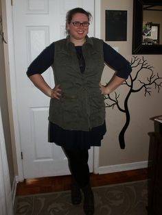 What Mama Wears: Dressed up/Dressed down. Navy dress, military inspired cargo vest, black tights. Mom style, mom fashion, plus size style, plus size fashion.