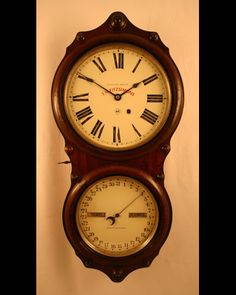 double dial wall clock with rosewood case...original finish...Circa 1880