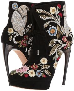 Beautifully stitched-on floral and wildlife embellishments embroidered up through vamp. Create a look that everyone will remember when they see you wearing your Alexander McQueen horn heel booties!