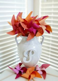ahhh, pinwheels! Table decoration, then send them home with supplies to make one with their kids.