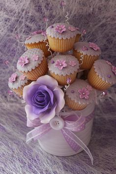 Purple Cupcake Bouquet. PERFECT on tables at a wedding. It means one could pay less for a smaller bridal cake.  Would be PERFECT!