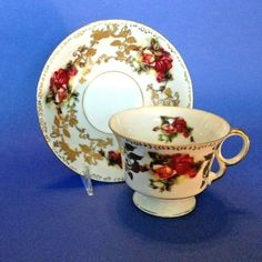 And Raised Gold Moriage Leaves. Royal Sealy China - Made In Japan. Pedestal Tea Cup And Saucer. And Gold Gilded Handle Rims and Accents. Tea Cup Saucer, Tea Cups, Red And Yellow Roses, Gold Gilding, Pedestal, Bone China, Tea Time, Vintage Teacups, Chocolate Cups