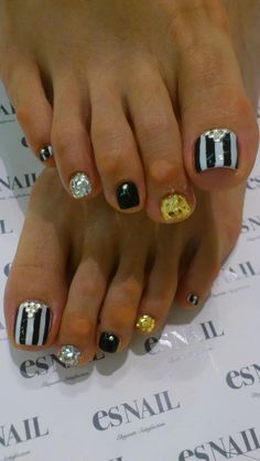 cute stripe and black, white & gold accent nails!