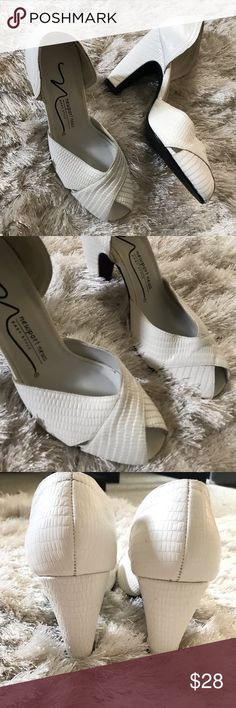 b5343733fa56 Vintage White Leather Pumps Made by Newport News. These vintage heels are  timeless and versatile