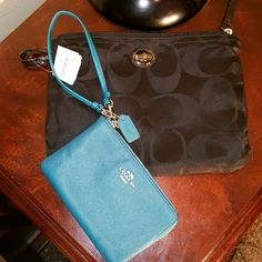Coach Black satin Monogram pouch & Teal Wristlet Coach Black satin logo Monogram pouch & Teal wristlet. This pouch is perfect for a cosmetics bag or a small bag for traveling. It originally came with a large bag that it snapped into but I gave that to my mama! Lol. Brand new with tags. 10 inches wide X 7 1/2 inches high. The Wristlet appears to be brand new also, beautiful Teal lightly Pebbled leather. 6 inches wide X 4 inches high Coach Bags