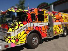 Snowmass Village fire trucks dressed to kill for the summer! Home of Aspen Yoga Mats, colorful custom embroidered yoga mats