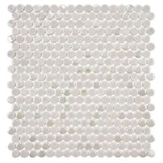$7.45 per sq ft.   The Merola Tile Cosmo Penny Round Ash 11-1/4 in. x 12 in. Porcelain Wall Tile is a new take on the classic penny-round mosaic tile. It is constructed of solid porcelain with three different glazed finishes: matte, glossy and iridescent. Use this mosaic tile on any wall surface, indoor or outdoor, for a modern look.