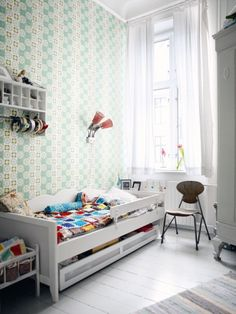 Another colourful kids room. Cute idea for headband storage.