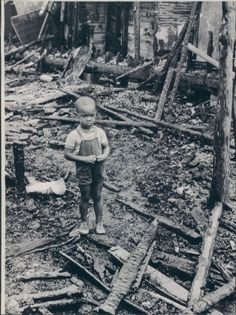 """Ohh...the poor little sweetheart. He looks so very sad.  """"Detroit Riots""""(1967)"""