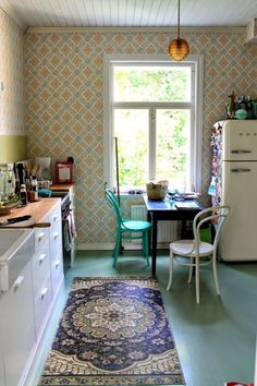 Vintage Wallpaper:  One easy way to throw it back? Throw up some wallpaper, whether the polka dot backsplash of the '50s or the bold, busy prints from the '60s.